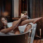 lady shaving her leg